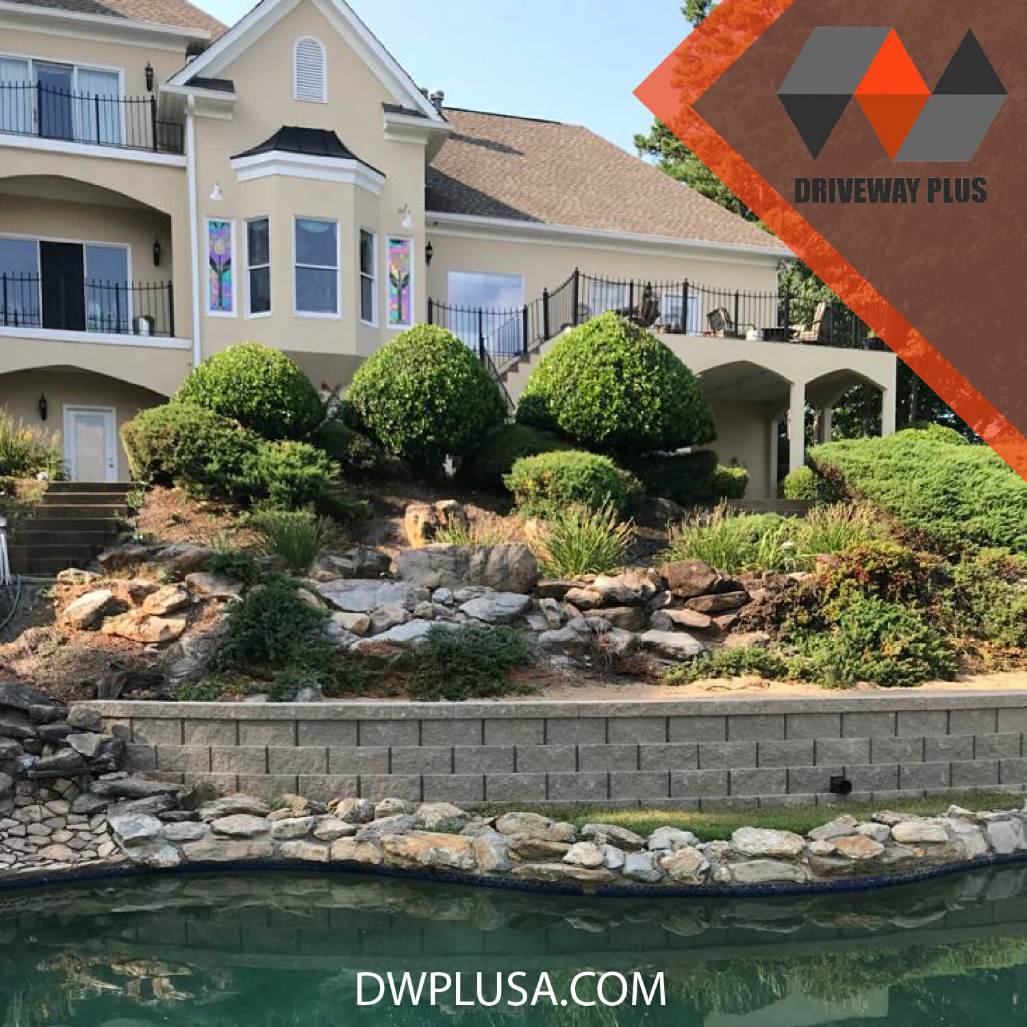 Retaining wall in front a big house with a hot tube